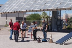 A group of students works with Solar energy equipment.